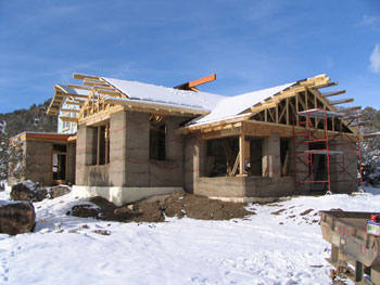rammed earth home under construction